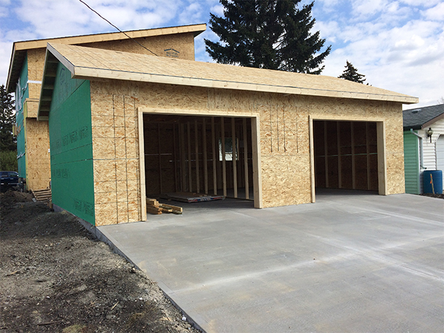 Custom house at framing stage of construction. House Framing Experts  Edmonton  Smith Built Homes   Smith Built Homes